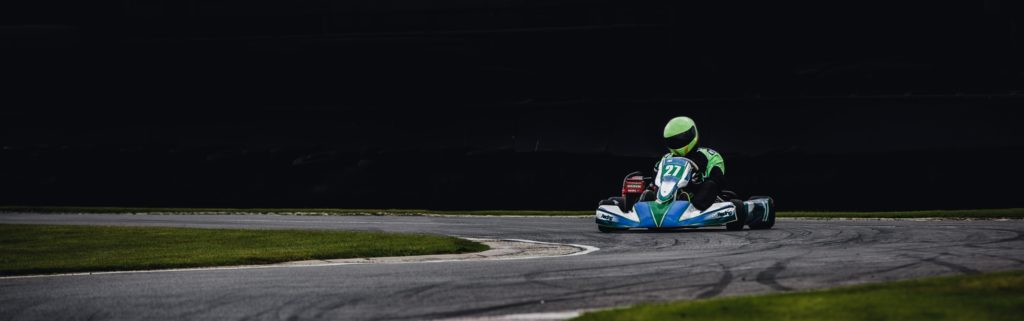 Man Wearing Green Helmet Riding Go Kart 821723 (2)